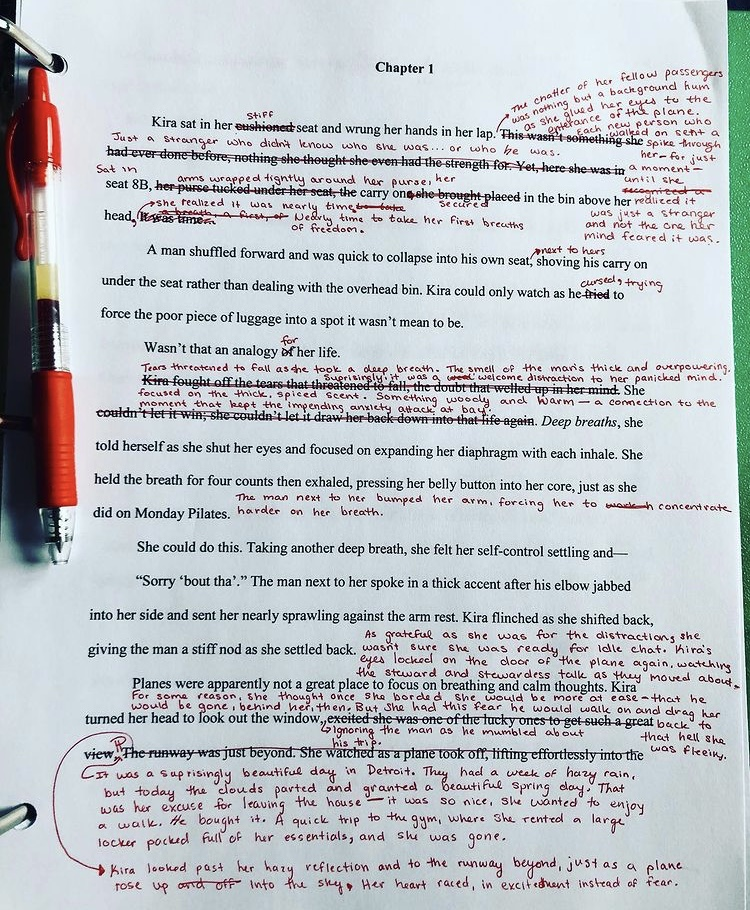 A page of a manuscript marked in red with edits.